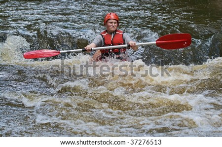 great image of a teenager girl white water kayaking