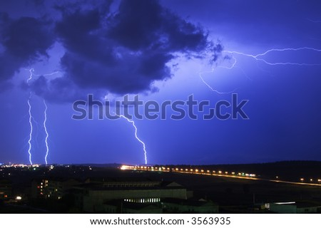 great lightning at night in the big town - stock photo