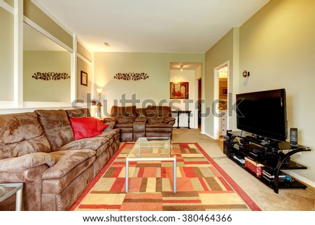 Great living room with carpet and colorful rug. - stock photo