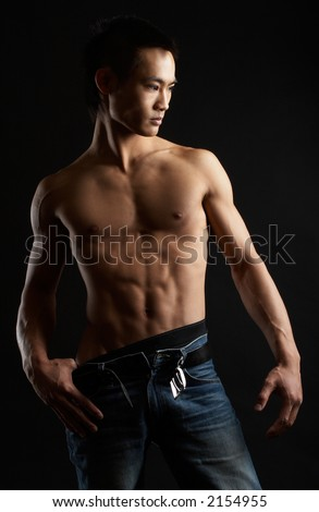 Great looking asian guy shot in studio - artistic pose