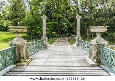 Great Men's Bridge in English Garden (Jardin Anglais, 1817). Famous Chateau de Chantilly (Chantilly Castle, 1560) - historic chateau, town of Chantilly, Oise, Picardie, France. - stock photo