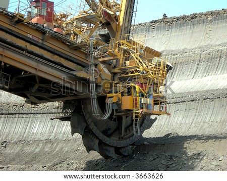 Great mining wheel of coal digger is in action - stock photo