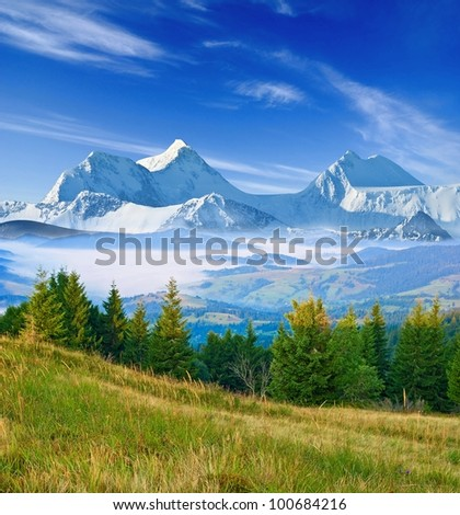 great mountains in a mist - stock photo