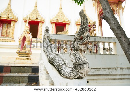 Great naga statues stucco decorated along side of stairs