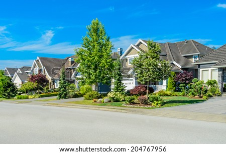 Great neighborhood. Homes on the empty street in the suburbs of the North America. Canada. - stock photo