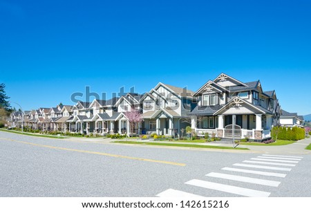 Great neighborhood. Row of the houses, homes on empty street in suburbs of Vancouver, Canada. - stock photo