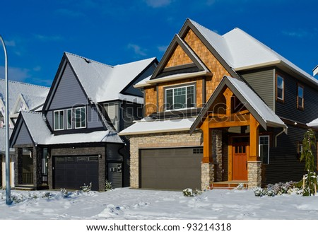 Great neighborhood. The homes covered with snow. Winter  in suburbs of the north America. Vancouver. - stock photo