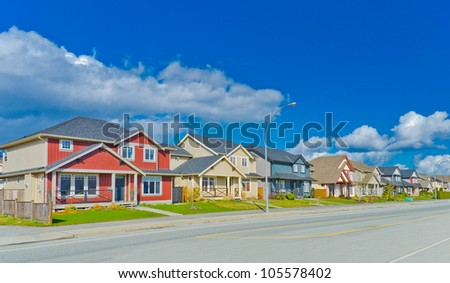 Great neighborhood with empty street in the suburbs of  Vancouver. Canada. - stock photo
