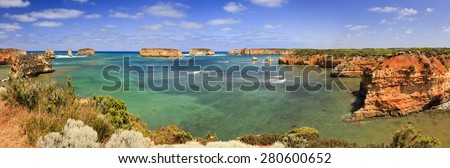 Great Ocean Road Boat bay panoramic view from elevated coastal lookout on sunny summer day. Clean transparent water of southern ocean surrounded by sandstone rocks of scenic coastline - stock photo