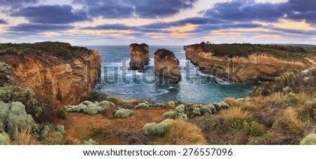 Great ocean road landmarks in VIctoria, Australia. Panoramic view on 2 disconnected rocks in a bay from Loch Ard GOrge lookout in Port Campbell national park - stock photo
