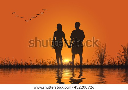 Great photo with a couple at sunset and water reflection - stock photo