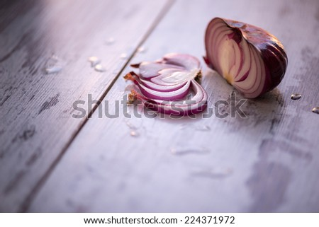 Great ripe tempting onion lying on the wooden table is lure for everyone - stock photo