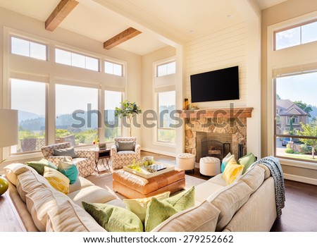 Great Room in Large House: Beautiful living room with hardwood floors and fireplace in new luxury home - stock photo