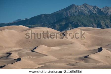 Great Sand Dunes and Sangre de Cristo Mountains in Great Sand Dunes National Park near Mosca, Colorado - stock photo