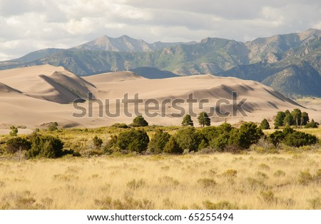 Great Sand Dunes National Park and the Sangre de Cristo Mountain Range - stock photo