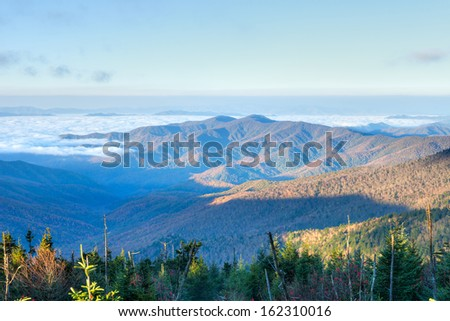 Great Smoky Mountains at sun rise, with clouds in valley. - stock photo