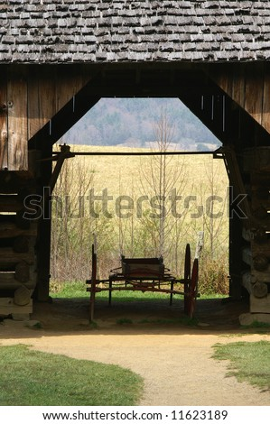 Great Smoky Mountains National Park, Cades Cove, Tipton Homestead Barn and Wagon Vertical - stock photo