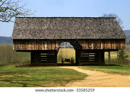 Great Smoky Mountains Tipton Homestead Double Cantilever Barn in Cades Cove Horizontal - stock photo
