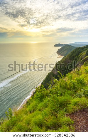 great sunrise from highland and seaside - stock photo