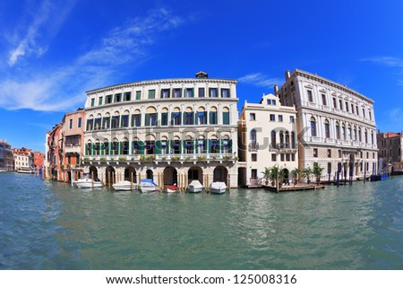 Great Venetian palazzo, surrounded by mirrored waters of the channel. Photo making the lens Fisheye - stock photo