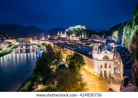 Great  view from the top on an evening city shining in the lights. Dramatic scene. Location famous place (unesco heritage) Festung Hohensalzburg, Salzburger Land, Austria, Europe. Beauty world - stock photo