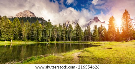 Great view of the foggy Lago Di Antorno in National Park Tre Cime di Lavaredo. Cadini di Misurina Range, Dolomites, South Tyrol. Location Auronzo, Italy, Europe. Dramatic overcast sky. Beauty world. - stock photo