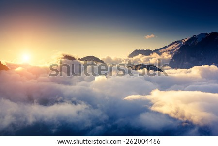 Great view of the foggy Val di Fassa valley with pass Sella. National Park. Dolomites (Dolomiti), South Tyrol. Location Canazei, Campitello, Mazzin. Italy, Europe. Dramatic scene. Beauty world. - stock photo