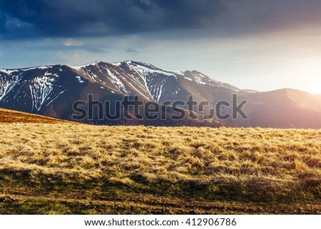 Great view of the snow peaks which glowing by sunlight. Dramatic and picturesque scene. Location place Carpathian, Ukraine, Europe. Beauty world. Retro and vintage style. Instagram toning effect. - stock photo