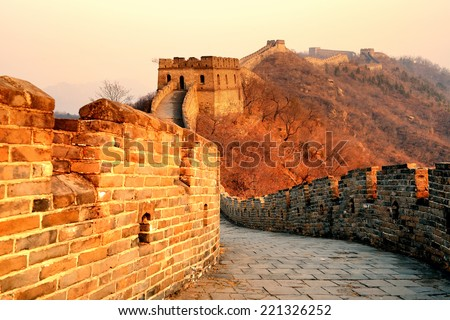 Great Wall sunset over mountains in Beijing, China. - stock photo