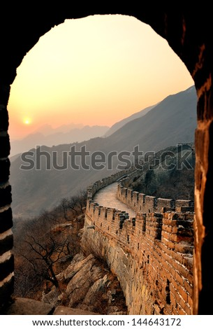 Great Wall sunset through window over mountains in Beijing, China. - stock photo