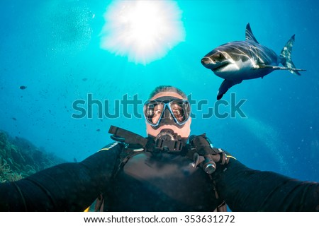 Great white shark ready to attack a scuba diver - stock photo