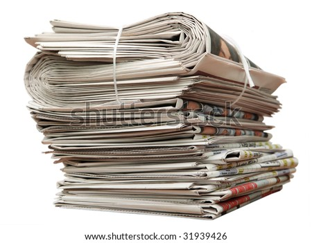 Greater pack of newspapers on a table - stock photo