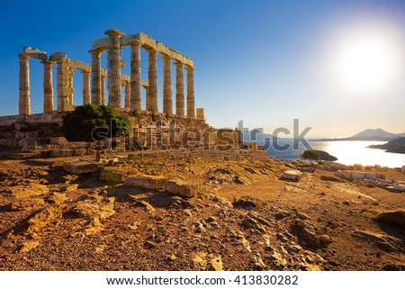 Greece. Cape Sounion - Ruins of an ancient Greek temple of Poseidon before sunset - stock photo