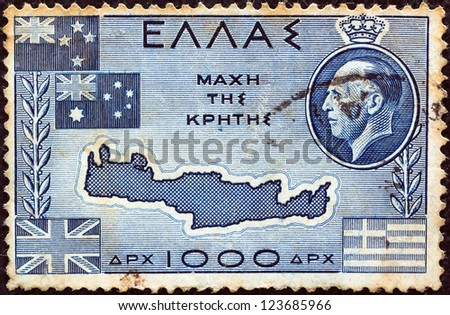 """GREECE - CIRCA 1950: A stamp printed in Greece from the """"Battle of Crete"""" issue shows Map of Crete, flags of Greece, Great Britain, Australia, New Zealand and King George II, circa 1950. - stock photo"""