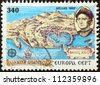 "GREECE - CIRCA 1992: A stamp printed in Greece from the ""Europa"" issue shows map of 15th century Chios and Christopher Columbus, circa 1992. - stock photo"