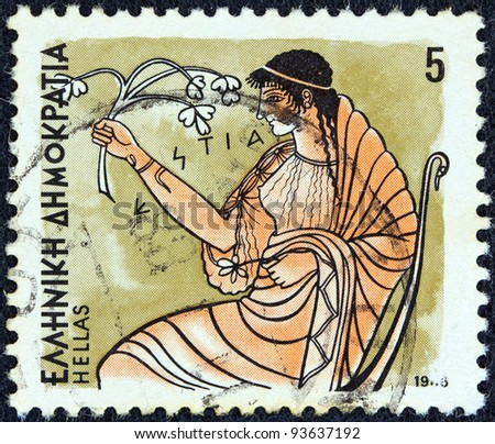 "GREECE - CIRCA 1986: A stamp printed in Greece from the ""Gods of Olympus"" issue shows goddess Hestia, circa 1986. - stock photo"