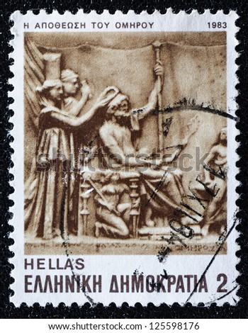 GREECE - CIRCA 1983: A stamp printed in Greece from the Homer's epics issue shows the deification of homer, circa 1983 - stock photo