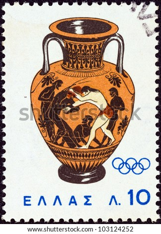 "GREECE - CIRCA 1964: A stamp printed in Greece from the ""Olympic Games, Tokyo"" issue shows Peleus wrestling with Atlanta (amphora) 500 B.C., circa 1964. - stock photo"