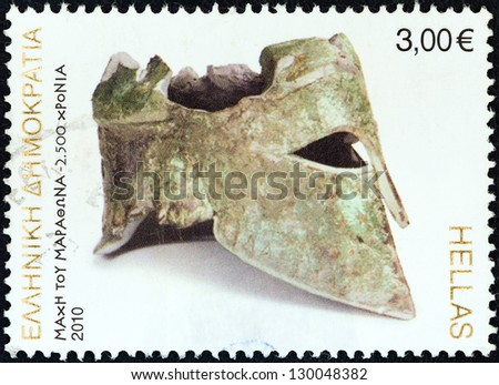 "GREECE - CIRCA 2010: A stamp printed in Greece from the ""2500th anniversary of Battle of Marathon"" issue shows bronze Corinthian helmet of Miltiades, circa 2010. - stock photo"