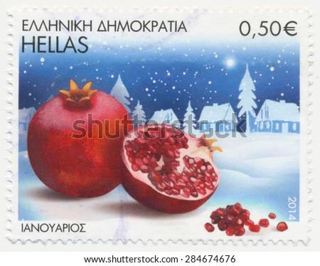 GREECE - CIRCA 2014: A stamp printed in Greece, shows pomegranate fruits, circa 2014 - stock photo