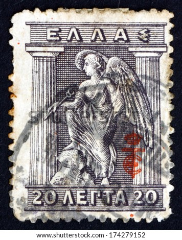 GREECE - CIRCA 1913: a stamp printed in the Greece shows Iris Holding Caduceus, Iris is Personification of the Rainbow and Messenger of the Gods, Greek Mythology, circa 1913 - stock photo