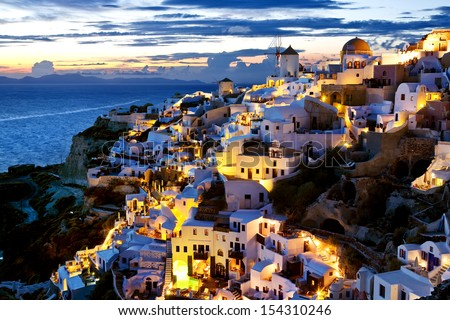 Greece. Cyclades Islands - Santorini (Thira). Oia town after sunset - stock photo