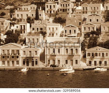 Greece. Dodecanesse. Island Symi (Simi). Colorful houses. In Sepia toned. Retro style
