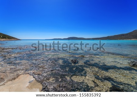 Greece elafonisi island beach at summer, exotic seaside view of clear sea water with blue sky