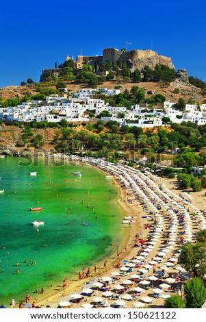 Greece holidays, Rhodes island, Lindos beach - stock photo