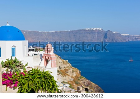 Greece, island of Santorini. View of the Church and the bell tower above the sea - stock photo
