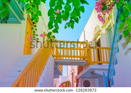 Greece Mykonos, wooden bridge connecting houses over narrow street - stock photo
