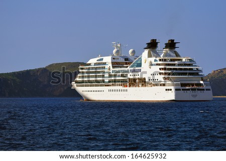 GREECE, PYLOS - 26 SEP: Cruise ship Seabourn Odyssey shown in Navarino bay on sep 26, 2013, in Pylos. Although, at 32,000 GRT and length 650 feet, it accommodates just 450 guests in 225 luxury suites