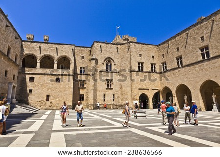 GREECE, RHODES - JUNE 11, 2015: Tourists visiting The Palace of the Grand Master of the Knights of Rhodes a medieval castle in the city of Rhodes. - stock photo
