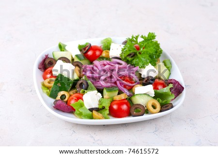 greece salad at plate isolated on a white